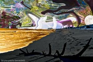 tracks on surreal brown sea shore sand to multicolored dappled sky