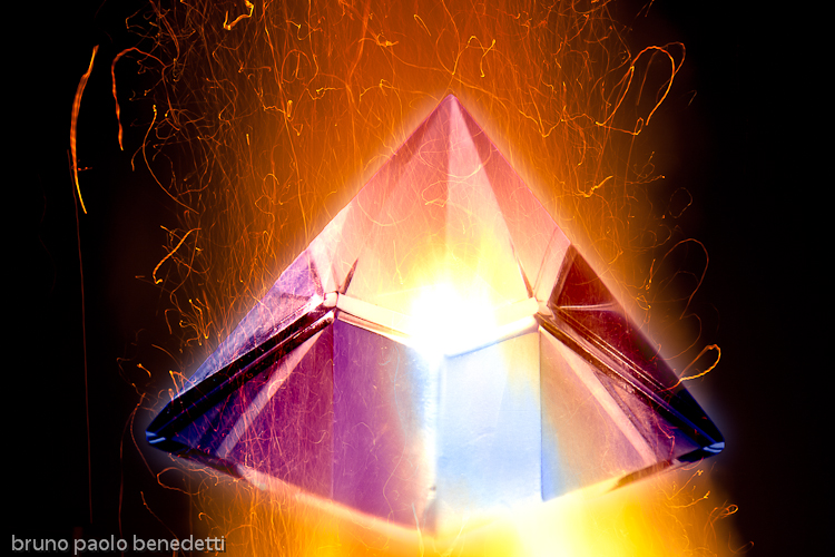 cristal pyramd burning in fire flame, alchemy black work representation