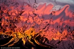 abstract red and yellow loke flames fluid shape in the sky