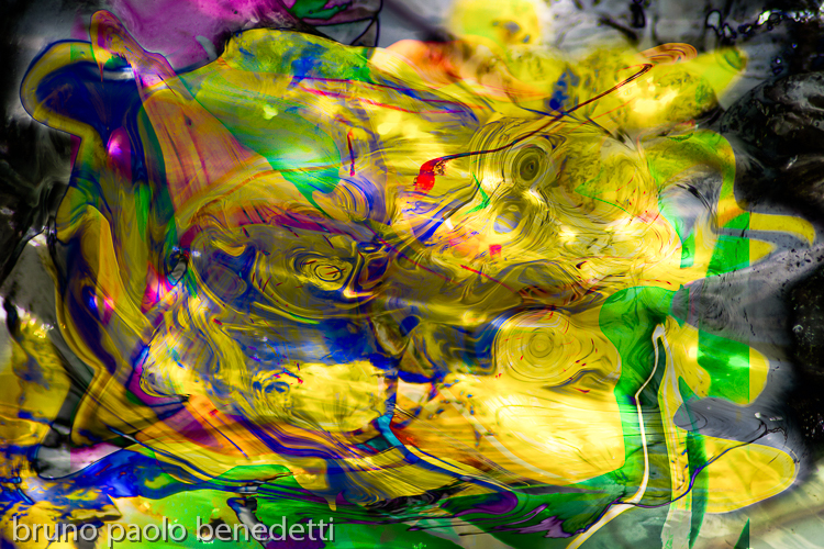 starry lights and mottled colors in abstract image with yellow dominant