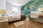 mural print with abstract water like floral pattern on bedroom wall