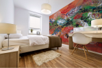 adhesive mural print with abstrat orange color on bedroom wall