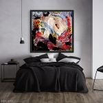 canvas print with abstract dynamic pattern in red, white and black dominant colors on a bedroom wall