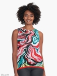 xmas design woman sleeveless top with Christmas colors abstract image in tones of red green, white, black and yellow